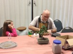 My daughter working with Tony to re-pot her bonsai.